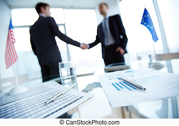Deal - Image of business documents and pens on workplace...