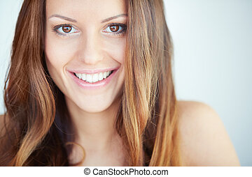 Happy lady - Close-up of happy woman looking at camera