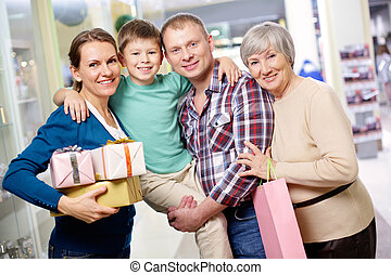 Family of shoppers - Portrait of happy family looking at...