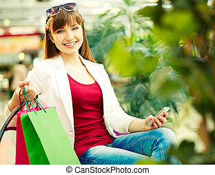 Happy shopper - Pretty lady with colorful shopping bags...