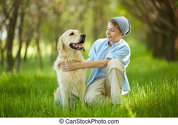 Two friends - Portrait of cute lad embracing his white...