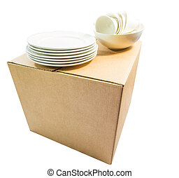 Cardboard Box and Crockeries over white background