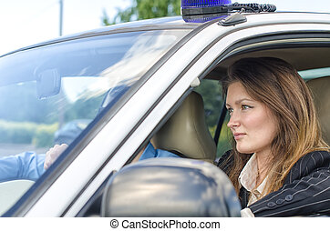 Young pretty female agent driving the car