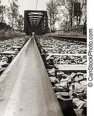 Old railway bridge in low angle view in Black and white