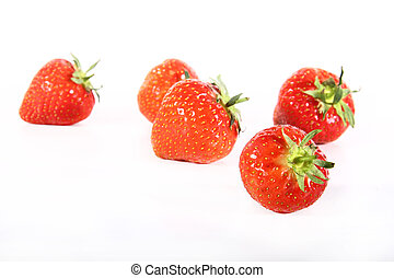 Strawberries scattered - five fresh strawberries scattered...