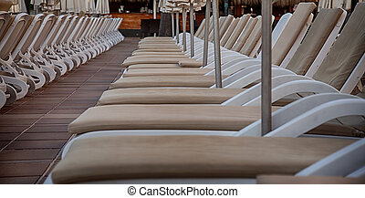 Pool side - Sun beds by pool