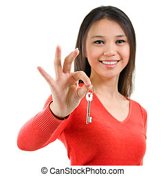 First own house key - Attractive young woman holding her...