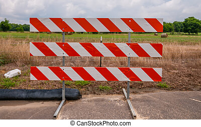 road blocked sign standing at road edge