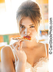 sexy woman biting piece of pizza - picture of sexy woman...