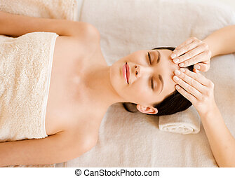 woman in spa - close up of woman in spa salon getting face...