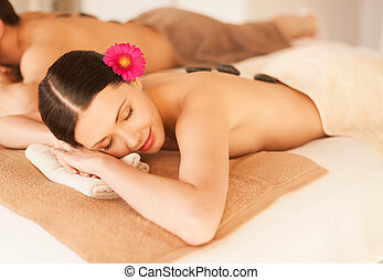 couple in spa with hot stones - picture of couple in spa...