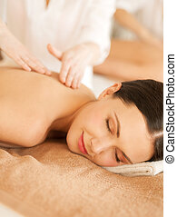 woman in spa - picture of woman in spa salon getting massage