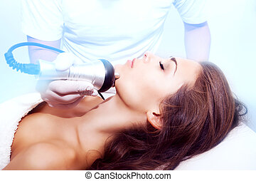 face treatment - woman face treatment in medical spa center