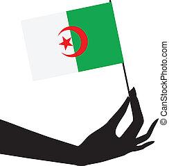 Algerian flag in hand - The symbol of statehood flag of...