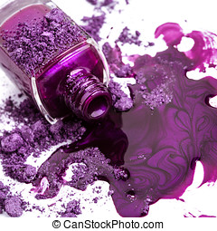 Purple nail polish and crushed eye shadow on white...