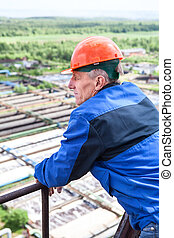 Senior male a manual worker at the industrial plant