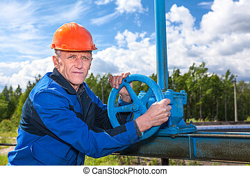 Senior manual worker with valve