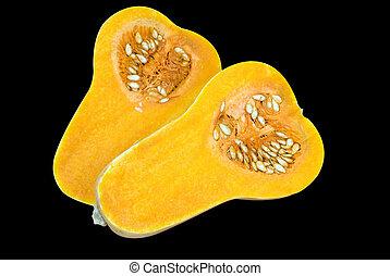Raw Butternut - Butternut vegetable cut in half showing the...