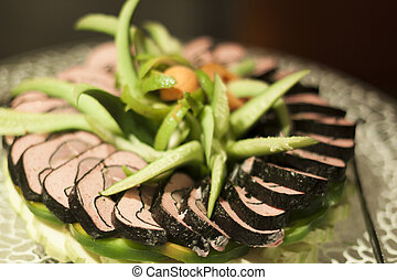 Ornated Sushi - Sushi pile ornated with cucumbers and...