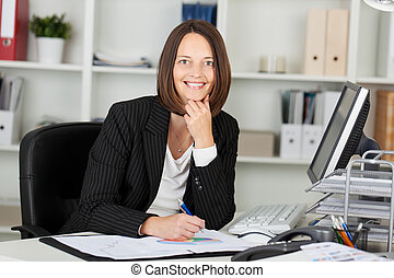 Portrait of a beautiful businesswoman working - Profile...