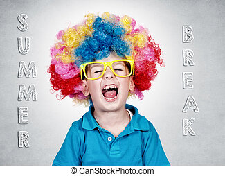 Happy boy with clown wig on summer break