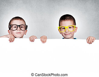 Twins brothers - Twins holding blank white space on gray...