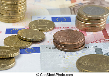 economic meltdown - bank-notes and eurocoins on it