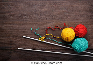 knitting needles and ball of threads - knitting needles and...