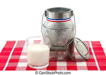 milk churn and glas of milk on a checkered table cloth