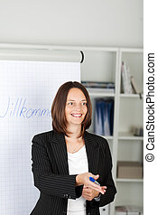 Businesswoman Pointing On Colleagues - Mid adult...