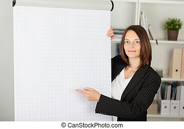 Confident Businesswoman Pointing At Flipchart