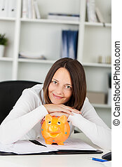 Woman with piggybank - Conceptual portrait of smiling woman...