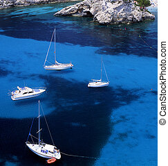 Four sail boats in the waters of Paleokastritsa, Corfu,...
