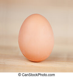 Egg On Wooden Table