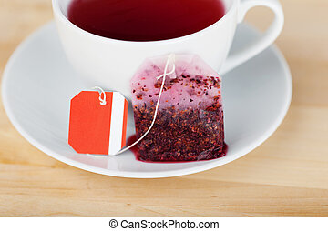 Tea Bag And Cup On Wooden Table