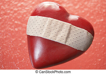 Broken Hearted - Plastic red heart on red rippled glass with...