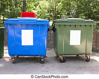 New colorful plastic garbage containers in a park