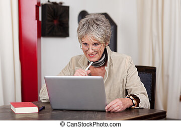 Grandmother using modern technology - Photograph of smiling...