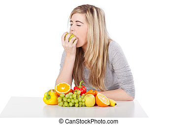 Cute teenage female eating lots of fruits - Portrait of a...