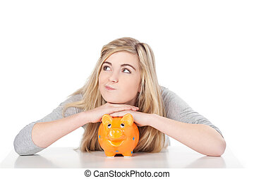 Cute teenage girl posing with piggy bank - Image of a cute...