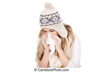 Teenage Girl In Knitted Hat Blowing Her Nose - Teenage girl...