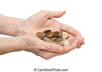 Senile hands - Coins in senile hands are isolated on a white...