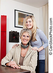 Teenage Girl With Grandmother At Home - Portrait of a...