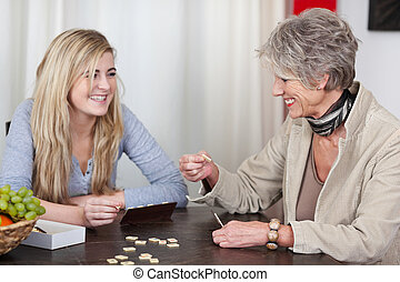 Grandmother And Granddaughter Having Fun - Happy and...