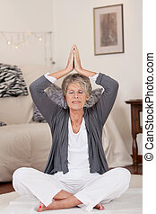 Relaxed Senior Woman During Yoga - Relaxed senior woman...