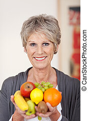 Smiling Older Woman With Fruits