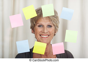 Smiling Senior Woman With Sticky Notes