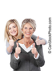 Grandma And Granddaughter Showing Thumbs Up - Portrait of...