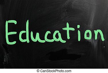 """""""Education"""" handwritten with white chalk on a blackboard"""