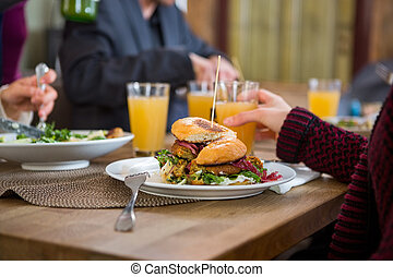Tasty Burger On Plate - Tasty burger in plate with people...